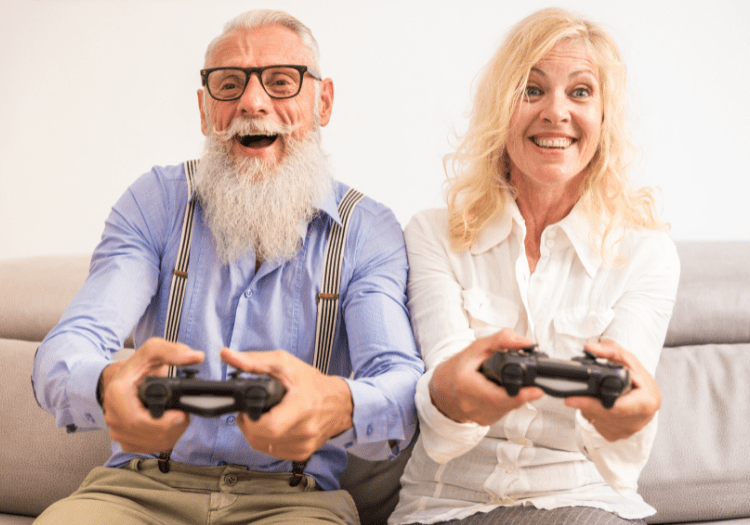 elder man and his daughter playing video games