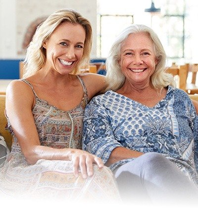 Woman and her mother sitting and smiling