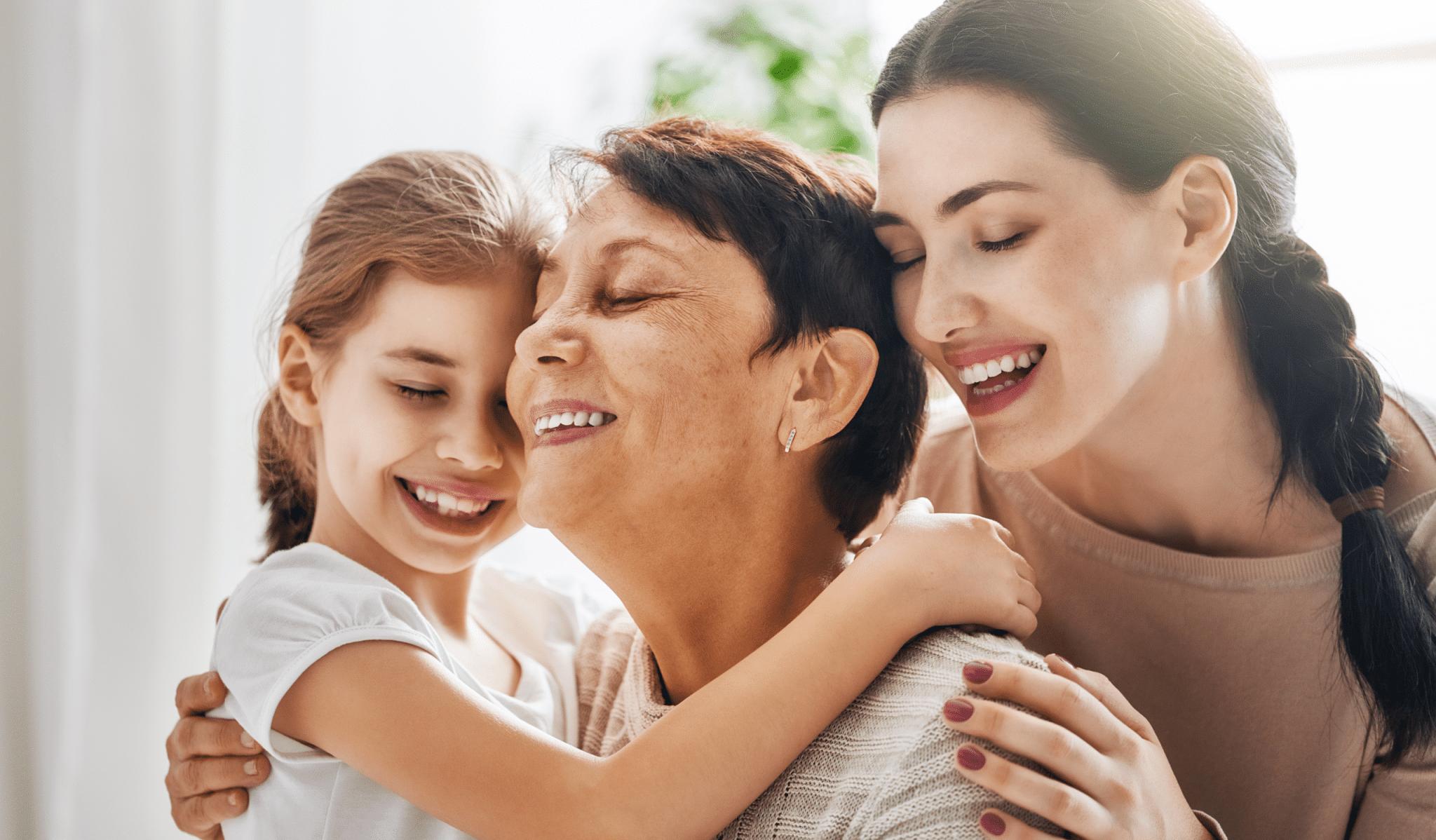 Three generations of women hugging