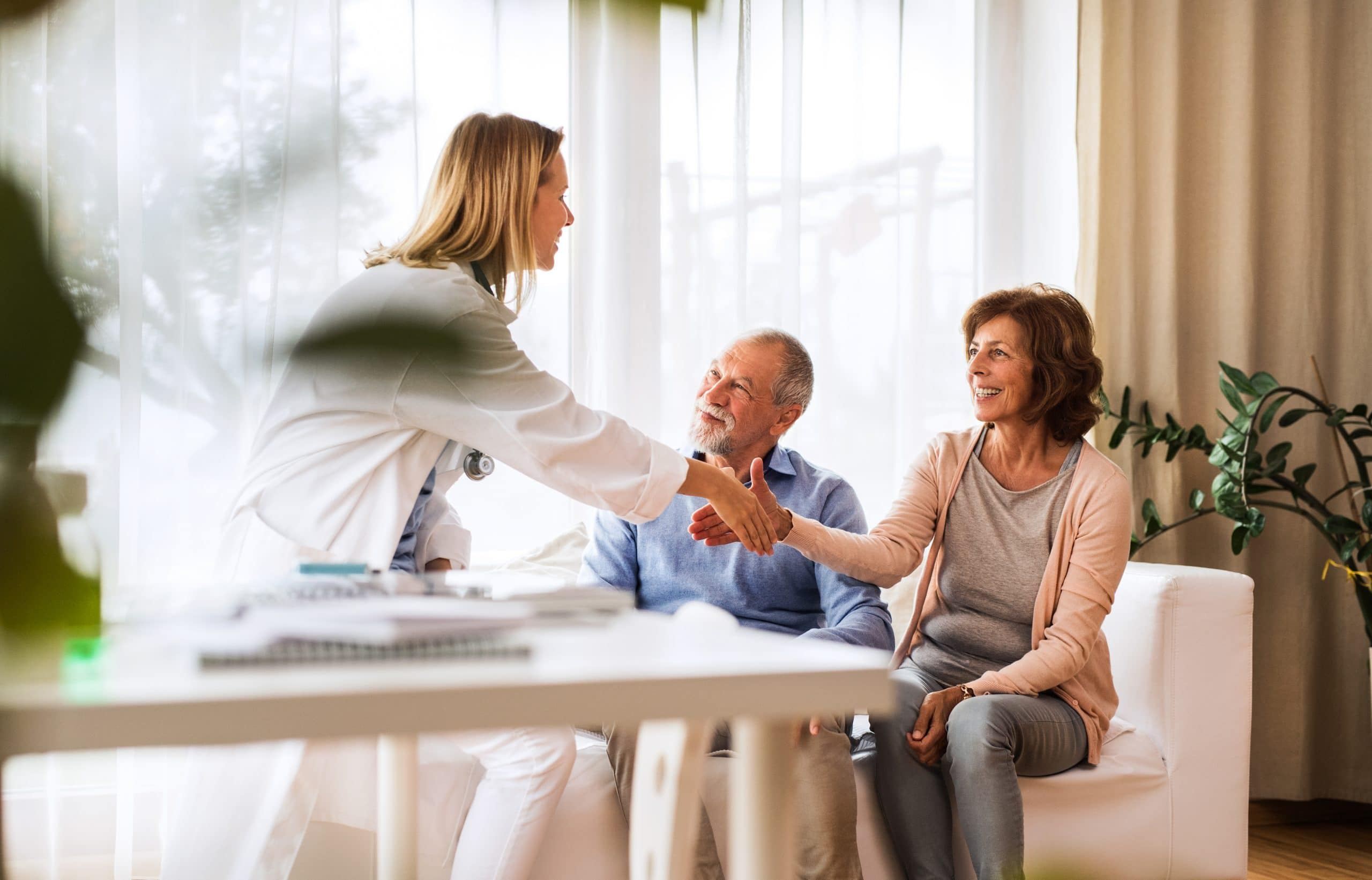 older couple speaking to a female doctor during a cognitive assessment